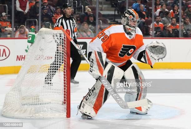 Carter Hart of the Philadelphia Flyers prepares to stop a shot on goal making his NHL debut against the Detroit Red Wings on December 18 2018 at the...