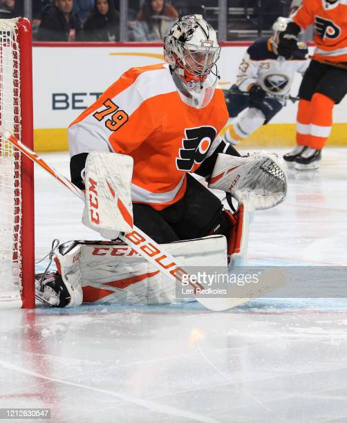 Carter Hart of the Philadelphia Flyers prepares to stop a shot on goal against the Buffalo Sabres on March 7 2020 at the Wells Fargo Center in...