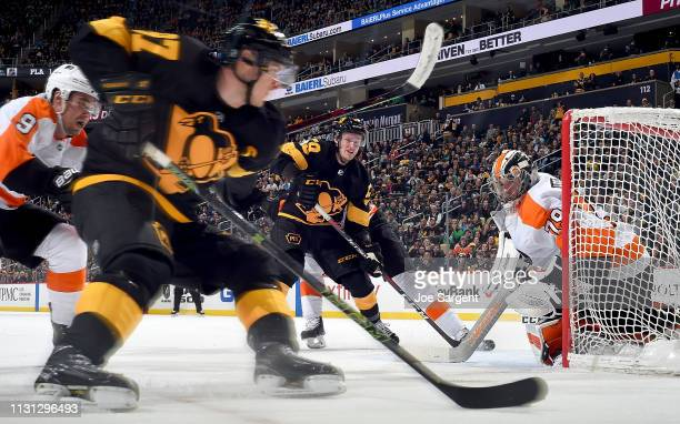 Carter Hart of the Philadelphia Flyers protects the net against Sidney Crosby of the Pittsburgh Penguins at PPG Paints Arena on March 17 2019 in...