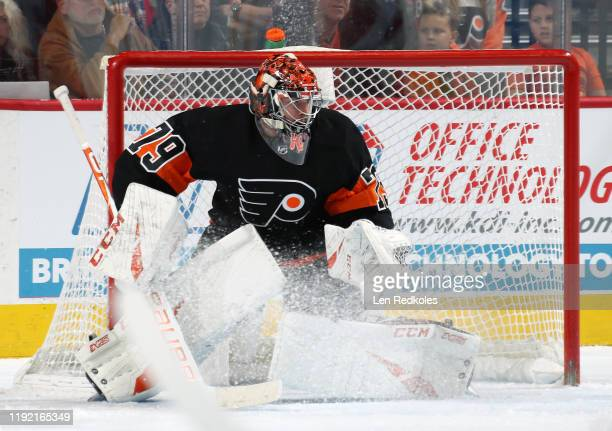 Carter Hart of the Philadelphia Flyers reacts to the play along the boards against the Detroit Red Wings on November 29 2019 at the Wells Fargo...