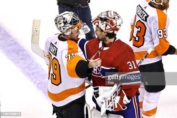 Carter Hart of the Philadelphia Flyers shakes hands with Carey Price of the Montreal Canadiens after the Flyers 3-2 win in Game Six of the Eastern...