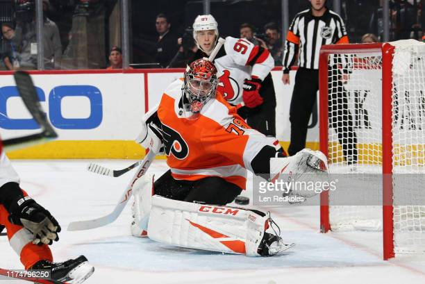 Carter Hart of the Philadelphia Flyers sprawls across his crease to make a save in the second period against the New Jersey Devils on October 9 2019...