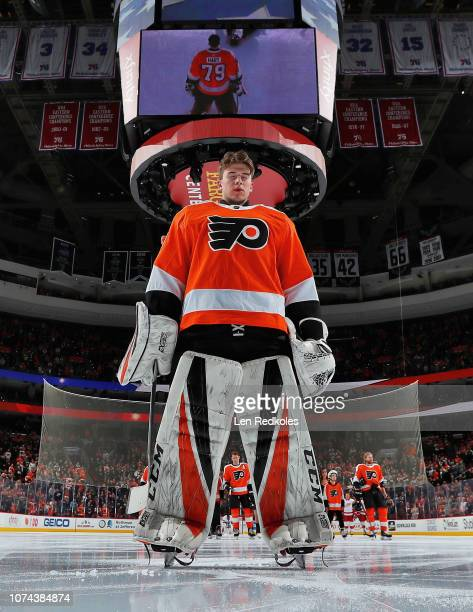 Carter Hart of the Philadelphia Flyers stands for the National Anthem prior to making his NHL debut against the Detroit Red Wings on December 18 2018...