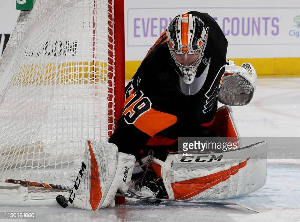 Carter Hart of the Philadelphia Flyers stops a shot in the first period against the Detroit Red Wings at Wells Fargo Center on February 16 2019 in...