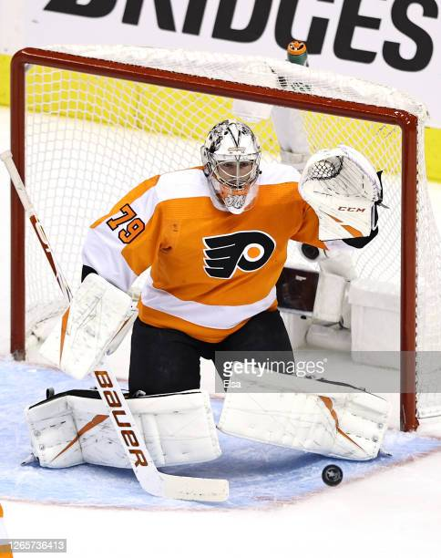 Carter Hart of the Philadelphia Flyers stops a shot in the first period against the Montreal Canadiens in Game One of the Eastern Conference First...