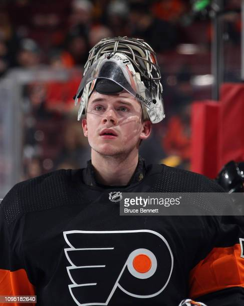 Carter Hart of the Philadelphia Flyers take a break during the second period against the Boston Bruins at the Wells Fargo Center on January 16 2019...