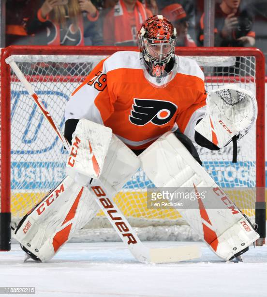 Carter Hart of the Philadelphia Flyers warms up against the Washington Capitals on November 13 2019 at the Wells Fargo Center in Philadelphia...