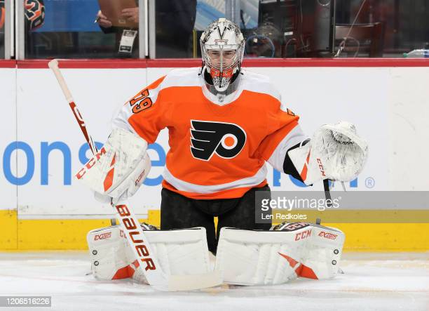 Carter Hart of the Philadelphia Flyers warms up against the Florida Panthers on February 10 2020 at the Wells Fargo Center in Philadelphia...