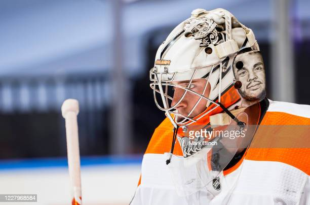 Carter Hart of the Philadelphia Flyers warms up before facing the Tampa Bay Lightning in an Eastern Conference Round Robin game during the 2020 NHL...