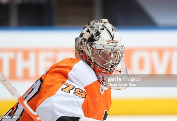 Carter Hart of the Philadelphia Flyers warms up before Game One of the Eastern Conference First Round of the 2020 NHL Stanley Cup Playoff at...