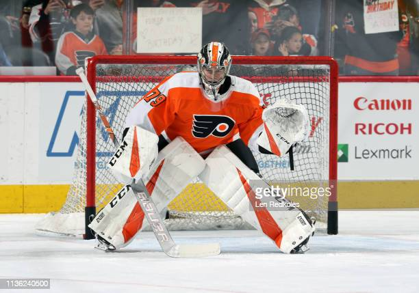 Carter Hart of the Philadelphia Flyers warmsup against the Ottawa Senators on March 11 2019 at the Wells Fargo Center in Philadelphia Pennsylvania
