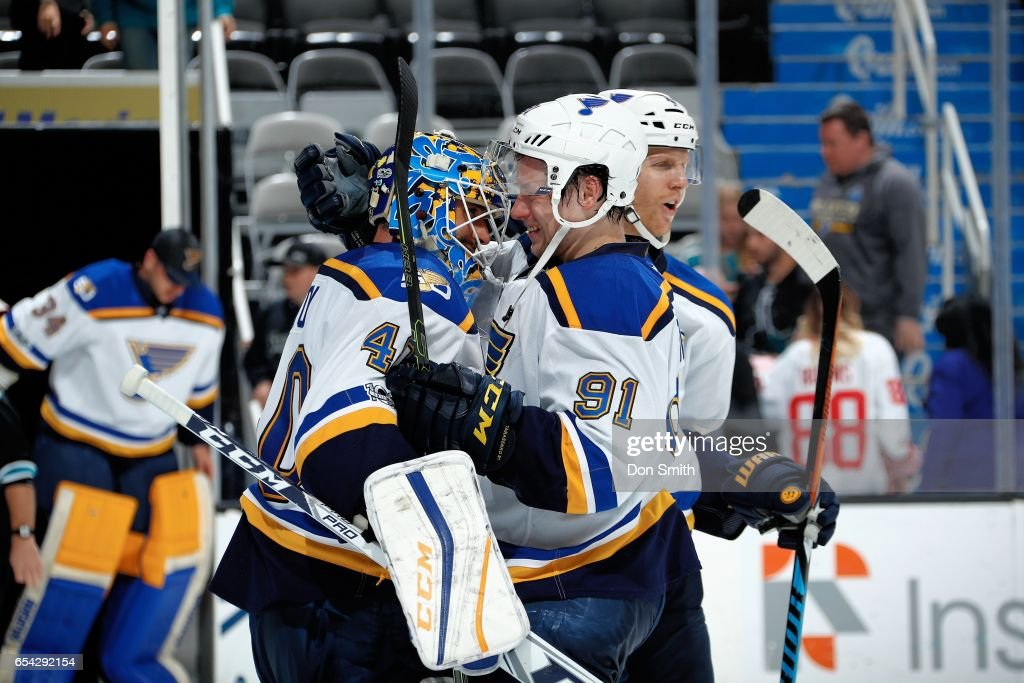 Carter Hutton #40 and Vladimir Tarasenko #91 of the St. Louis Blues celebrate their win over the Sharks after a NHL game at SAP Center at San Jose on March 16, 2017 in San Jose, California. The Blues defeated the Sharks 4-1.