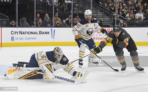 Carter Hutton of the Buffalo Sabres dives on the puck to make a save against Paul Stastny of the Vegas Golden Knights as Marcus Johansson of the...