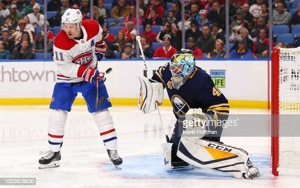 Carter Hutton of the Buffalo Sabres makes the save against Brendan Gallagher of the Montreal Canadiens on a tipped shot during the third period at...