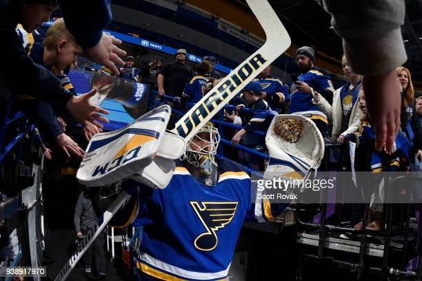 Carter Hutton of the St Louis Blues greets fans before taking the ice for warmups against the San Jose Sharks at Scottrade Center on March 27 2018 in...