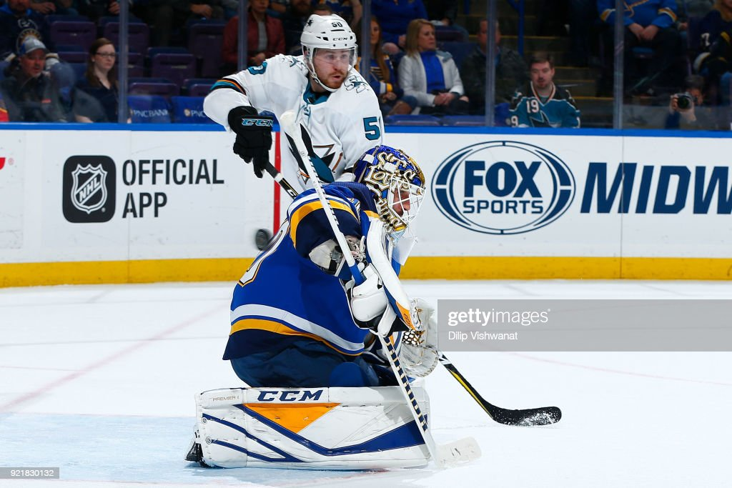 Carter Hutton #40 of the St. Louis Blues looks to make a save as Chris Tierney #50 of the San Jose Sharks attacks at Scottrade Center on February 20, 2018 in St. Louis, Missouri.