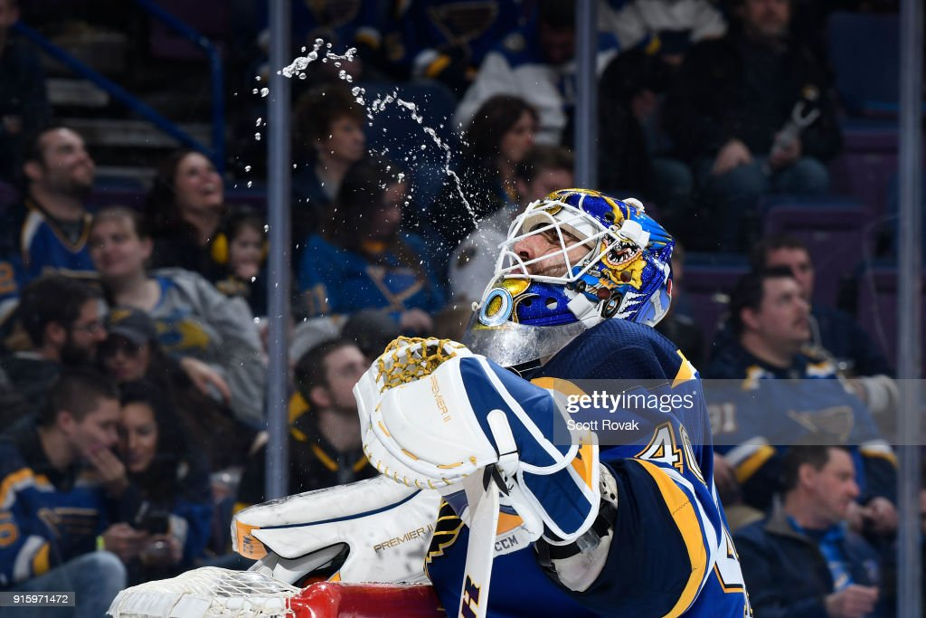 Carter Hutton #40 of the St. Louis Blues takes a water break during the game against the Colorado Avalanche at Scottrade Center on February 8, 2018 in St. Louis, Missouri.