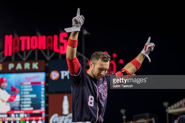 Carter Kieboom of the Washington Nationals celebrates after hitting a home run against the San Diego Padres during the eighth inning of his major...