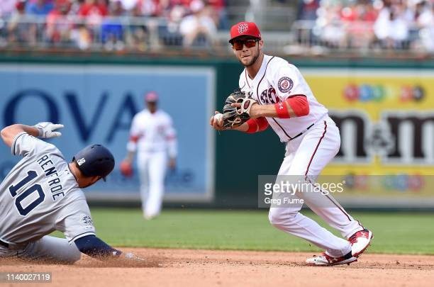 Carter Kieboom of the Washington Nationals forces out Hunter Renfroe of the San Diego Padres in the sixth inning to start a double play at Nationals...