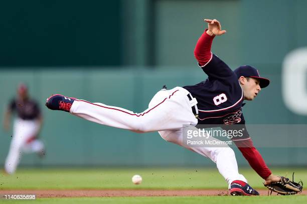 Carter Kieboom of the Washington Nationals is unable to field a ball that went for a tworun single off the bat of Jose Martinez of the St Louis...