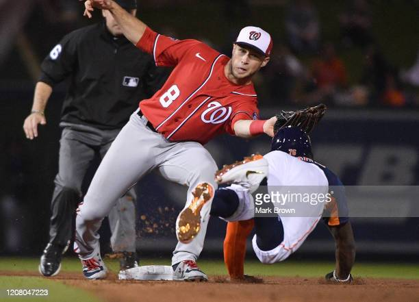 Carter Kieboom of the Washington Nationals tags Ronnie Dawson of the Houston Astros trying to steal second base in the second inning during the...