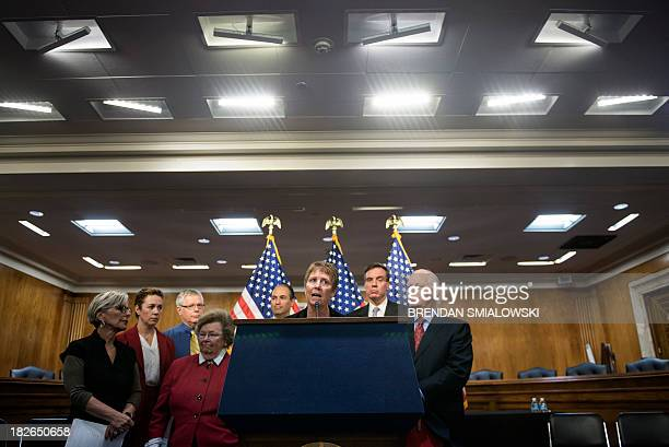 Carter Kimsey, who works with the National Science Foundation, speaks while with Senators and other federal workers listen during an event about the...