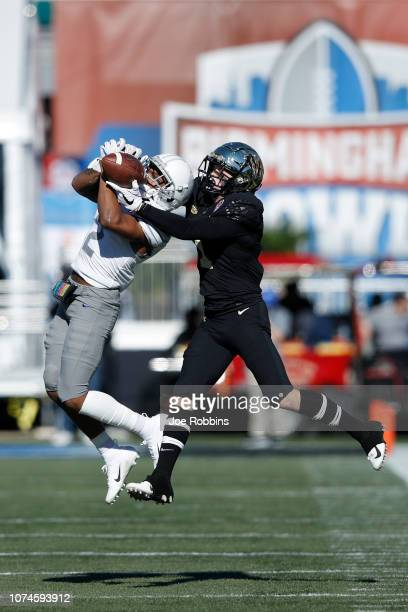 J Carter of the Memphis Tigers defends a pass intended for Alex Bachman of the Wake Forest Demon Deacons in the first quarter of the Birmingham Bowl...