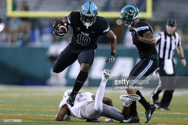 Carter of the Memphis Tigers tackles Darius Bradwell of the Tulane Green Wave during the first half at Yulman Stadium on September 28, 2018 in New...