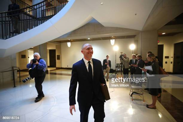 Carter Page walks away after speaking to the media after testifying before the House Intelligence Committee on November 2 2017 in Washington DC The...