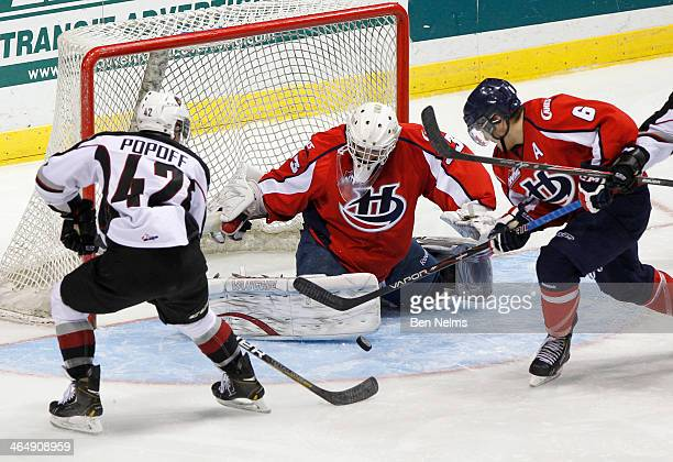 Carter Popoff of the Vancouver Giants is stopped by goaltender Jonny Hogue of the Lethbridge Hurricanes during the second period of a WHL game at the...