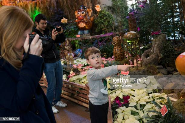 Carter Reardon of Fredericksburg Va checks out the US Botanic Garden's annual model train exhibit which features roadside attractions from around the...