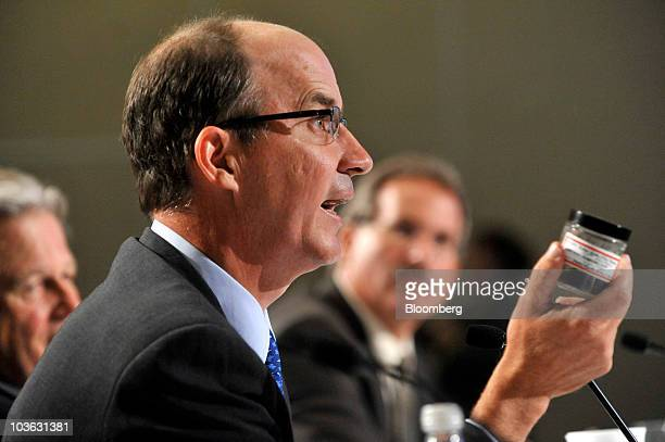 Carter Roberts, president and chief executive officer of the World Wildlife Fund, holds a sample of oil from Prince William Sound as he testifies at...