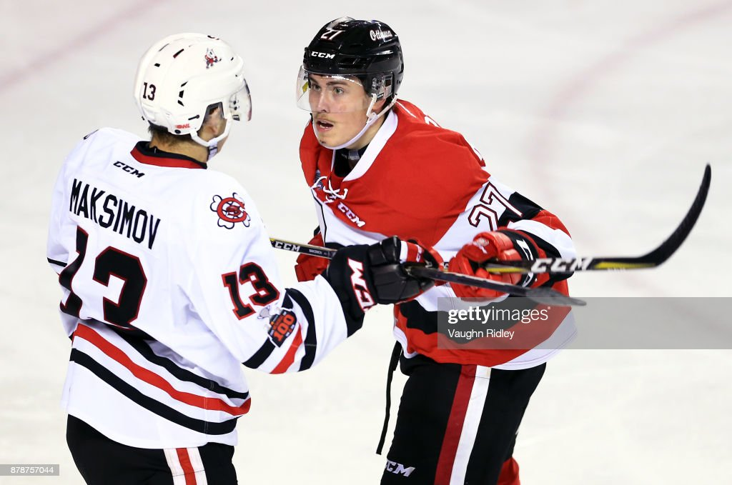Carter Robertson #27 of the Ottawa 67's battles with Kirill Maksimov #13 of the Niagara IceDogs during the third period of an OHL game at the Meridian Centre on November 24, 2017 in St Catharines, Ontario, Canada.