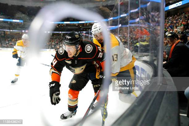 Carter Rowney of the Anaheim Ducks and Nick Bonino of the Nashville Predators fight for control of the puck during the first period at Honda Center...