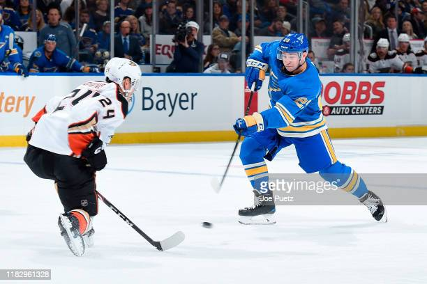 Carter Rowney of the Anaheim Ducks attempts to block a shot from Vince Dunn of the St. Louis Blues at Enterprise Center on November 16, 2019 in St....