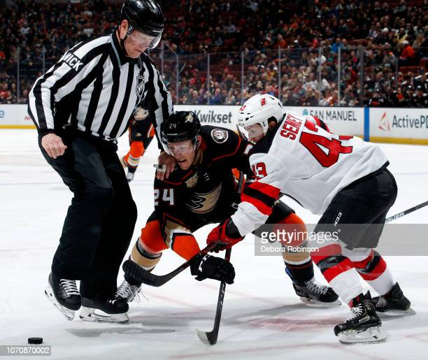 Carter Rowney of the Anaheim Ducks battles in a faceoff against Brett Seney of the New Jersey Devils during the game on December 9 2018 at Honda...