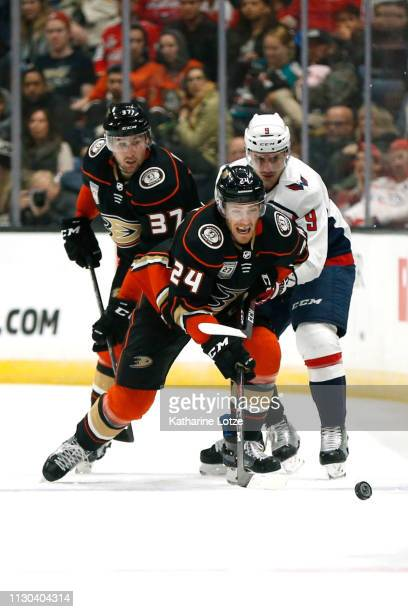 Carter Rowney of the Anaheim Ducks fights to break free from Dmitry Orlov of the Washington Capitals during the second period at Honda Center on...