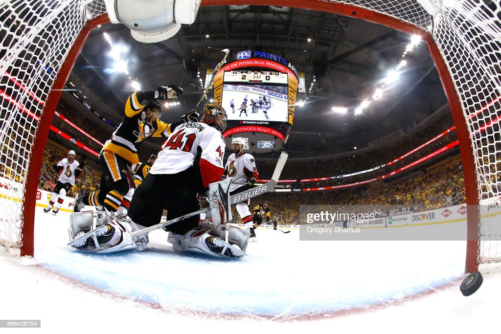 Carter Rowney #37 of the Pittsburgh Penguins celebrates after Bryan Rust #17 scored a goal against Craig Anderson #41 of the Ottawa Senators during the first period in Game Five of the Eastern Conference Final during the 2017 NHL Stanley Cup Playoffs at PPG PAINTS Arena on May 21, 2017 in Pittsburgh, Pennsylvania.