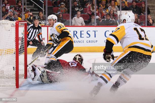Carter Rowney of the Pittsburgh Penguins scores a shorthanded goal past goaltender Antti Raanta of the Arizona Coyotes during the second period of...