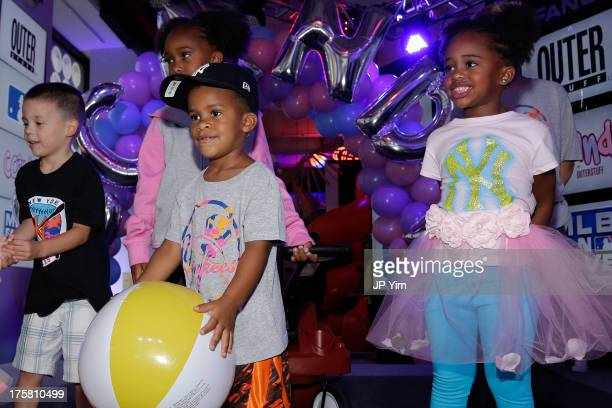 Carter Sabathia and Cyia Sabathia attend the CCandy Children's Clothing Line Launch at MLB Fan Cave on August 8 2013 in New York City