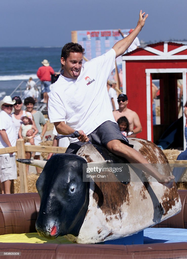 Carter Slade rides the mechanical bull at the Surf Rodeo and