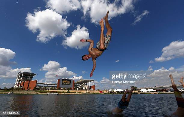 Carter Smith a junior student at Baylor University dives into the Brazos river before a game between the Southern Methodist Mustangs and the Baylor...