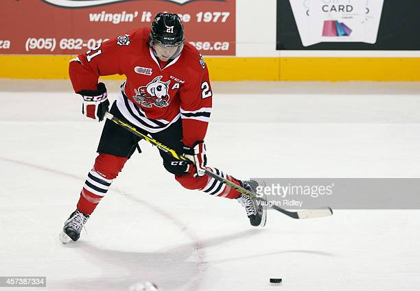 Carter Verhaeghe of the Niagara Ice Dogs shoots the puck during an OHL game against the Belleville Bulls at the Meridian Centre on October 16, 2014...