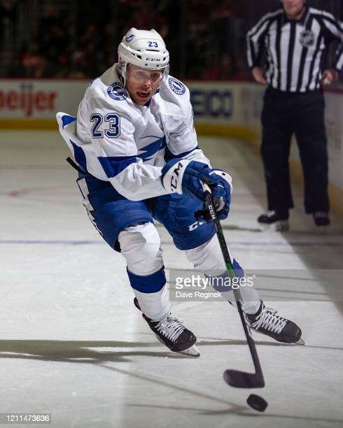 Carter Verhaeghe of the Tampa Bay Lightning skates after a loose puck against the Detroit Red Wings during an NHL game at Little Caesars Arena on...
