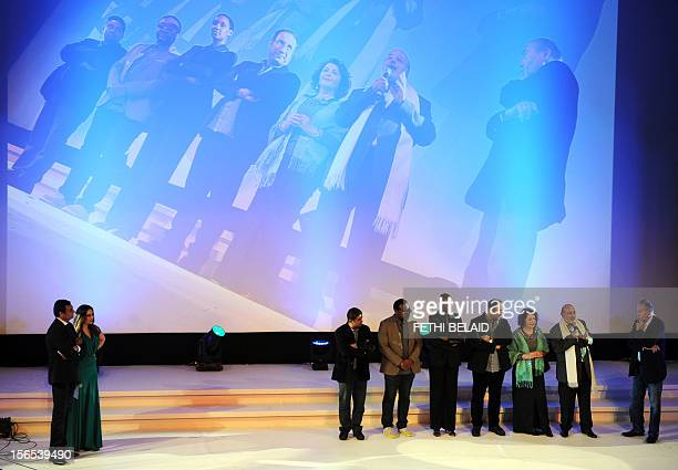 Carthage jury president and Tunisian screenwriter Ali Louati presents jury members during the opening night of the 24th session of the 'Journées...
