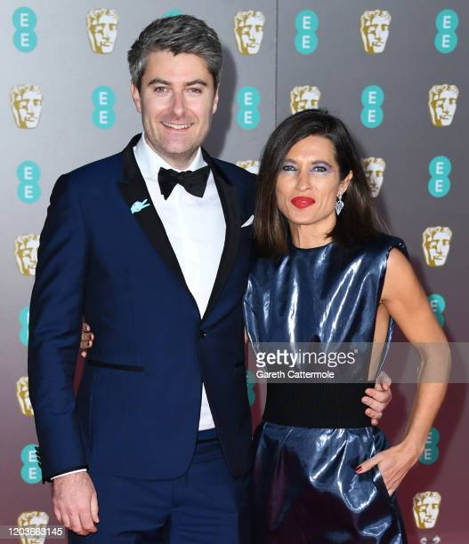Carthew Neal and Chelsea Winstanley attend the EE British Academy Film Awards 2020 at Royal Albert Hall on February 02 2020 in London England
