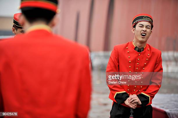 Cartier Boy reacts during the opening of the 'Cartier Treasures' exhibition at the Forbidden City September 4 2009 in Beijing China