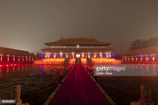 Cartier boys line up along the red carpet walkway of the forbidden city during the opening of the 'Cartier Treasures' exhibition at the Forbidden...