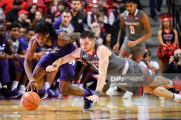 Cartier Diarra of the Kansas State Wildcats and Matt Mooney of the Texas Tech Red Raiders battle on the floor for a loose ball during the first half...