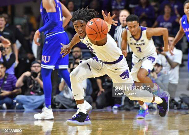 Cartier Diarra of the Kansas State Wildcats chases down a loose ball against the Kansas Jayhawks during the second half on February 5, 2019 at...